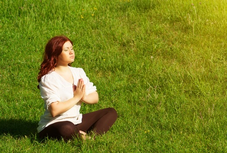 young redhead woman practicing yoga lotus pose  Stock Photo - 14446531