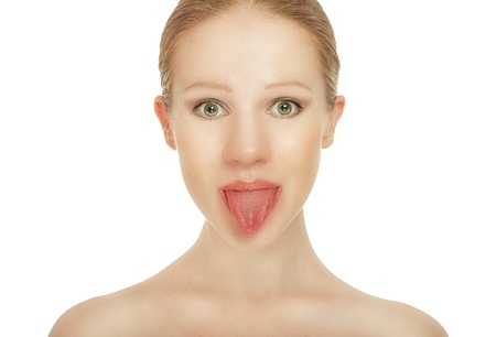 girl tongue: cheerful girl shows tongue isolated over white  Stock Photo
