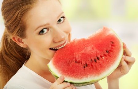 veganism: healthy happy girl eats the fruit, watermelon Stock Photo