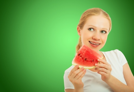 healthy pretty girl with a slice of watermelon  photo