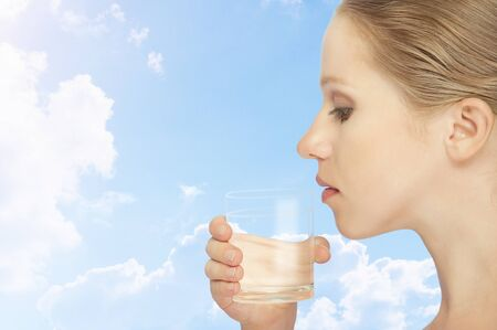 face of healthy woman and a glass of clean water photo