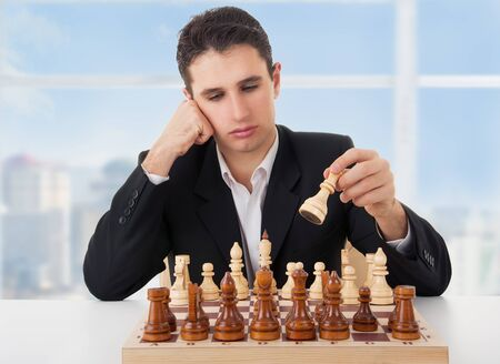 pawn adult: business man playing chess, making the first move
