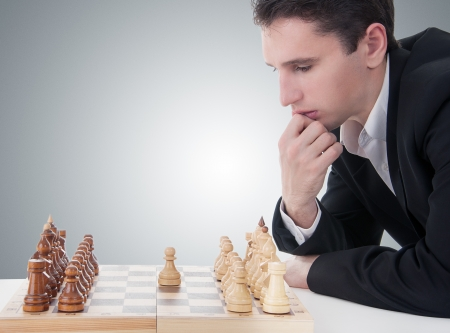 first move: business man playing chess, making the first move