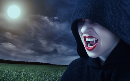 angry female vampire at sunset and moon photo