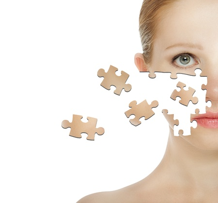 concept of cosmetic effects, treatment and skin care.  face of young woman of the particle puzzle photo