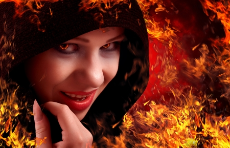 woman witch on fire, Halloween photo