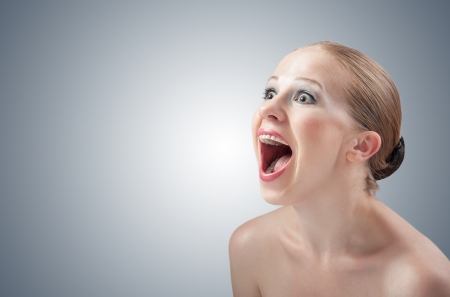 beautiful girl screaming angry aggressive and throws emotions, stress Stock Photo - 15691737