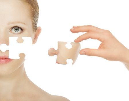 concept skincare with puzzles. Skin of beauty young woman before and after the procedure isolated on a white background Stock Photo - 15720933