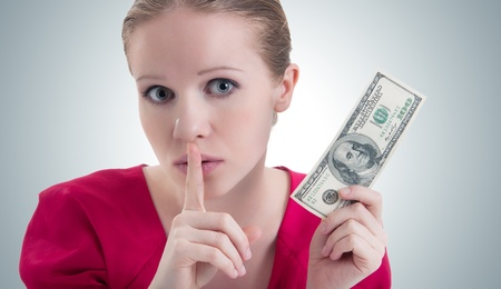woman with money, dollars  raised her finger to her mouth and says  photo