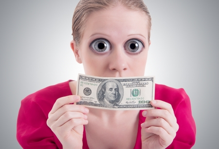 hundred dollar bill: money concept. woman with a big surprise open eyes and mouth closed dollar