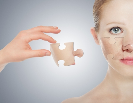 concept skincare with puzzles. Skin of beauty young woman before and after the procedure on a gray background photo