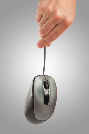computer mouse in hand man on a gray background photo
