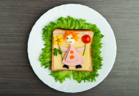 lunch meal: design food. Creative sandwich for a child with a picture little man