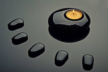 spa composition. black stones and a candle photo