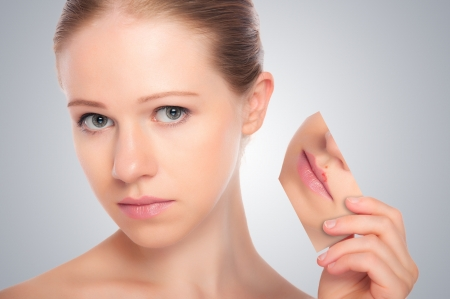 herpes: concept skincare . Skin of beauty young woman with herpes on lips, redness, skin problems, acne, rashes on a gray background Stock Photo