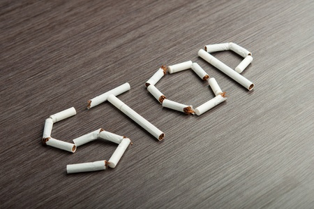 concept of the dangers of smoking. the word Stock Photo - 16310591