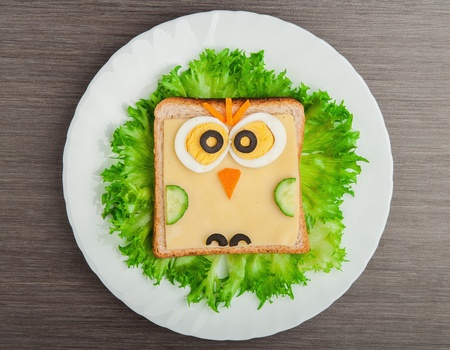 child food: design food. Creative sandwich for a child with a picture little  owl Stock Photo