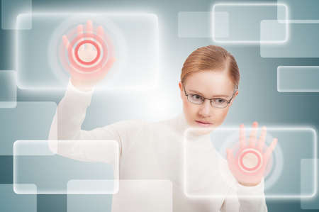 futuristic business concept interface. modern woman pushes on virtual buttons photo