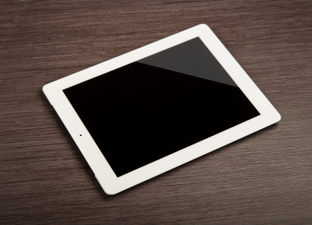 white blank tablet  pc on a desk photo