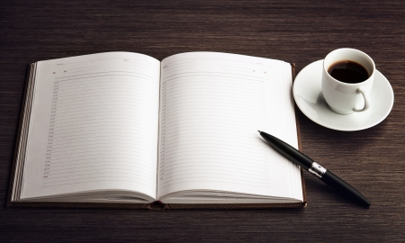 Open a blank white notebook, pen and cup of coffee on the desk Stock Photo - 17561675