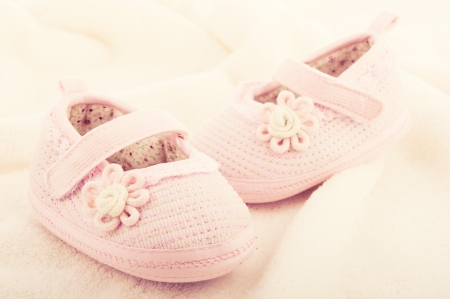 baptism background: pink baby booties shoes for newborn girl