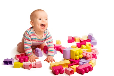 designer baby: little baby playing in the colorful designer toy blocks Stock Photo