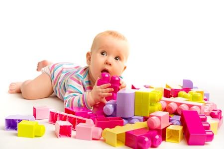 designer baby: baby playing in designer toy blocks