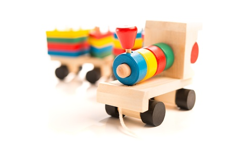 wooden educational toys  colorful train isolated on white background photo