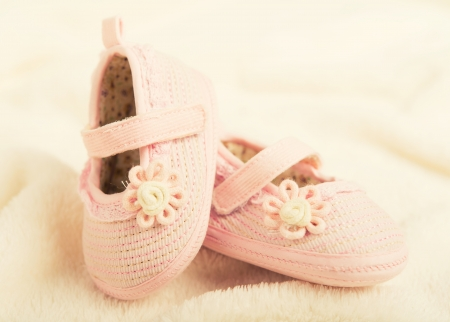 pink baby booties shoes for newborn girl photo