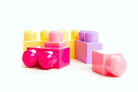 colorful block toy designer isolated on white background photo