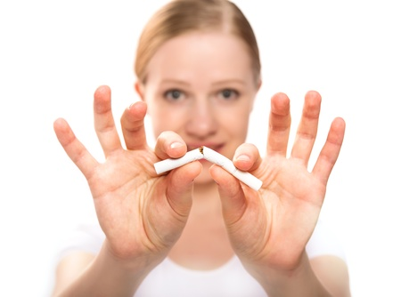smoker: A woman breaking cigarette  concept stop smoking