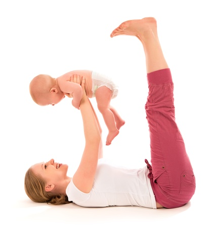 A mother and baby gymnastics, yoga exercises photo