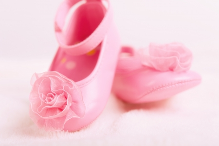 pink baby booties with rosette shoes for newborn girl photo