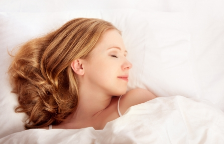 pillow sleep: young beautiful woman sleeping in white bed net Stock Photo