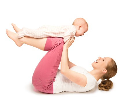 family exercise: A mother and baby gymnastics, yoga exercises isolated on white background