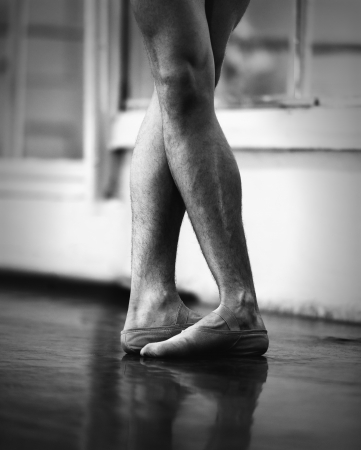 dancing pose: men ballet legs in the fifth position Stock Photo