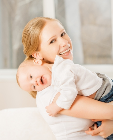 happy family. mother and baby little girl hugging Stock Photo - 19058398