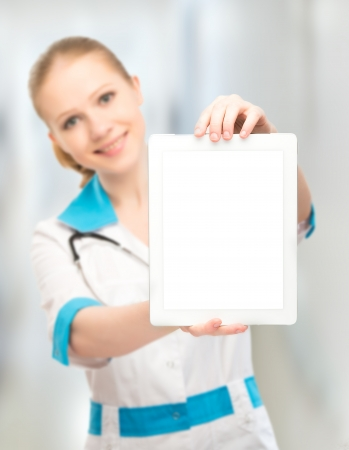 Doctor woman holding a blank empty white tablet computer photo