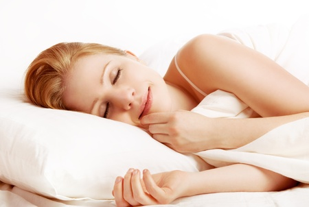 white pillow: young beautiful woman sleeping and smiles in his sleep in  bed