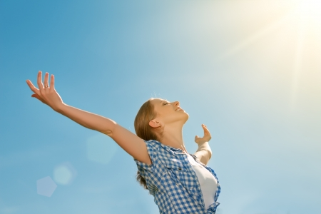 enjoy space: happy young woman open her arms to the sky and enjoying life Stock Photo