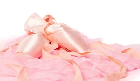 pointe: ballet shoes on a pink cloth isolated on white background