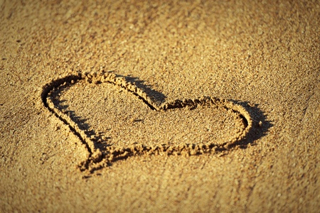 heart in sand: Concept of love. shape of heart drawn in the sand Stock Photo
