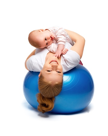 child ball: A mother and baby doing gymnastic exercises on the ball Stock Photo