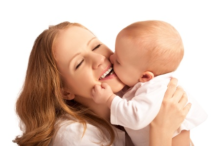 Happy cheerful family. Mother and baby kissing, laughing and hugging isolated on white background photo