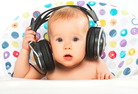 listen to music: beautiful happy baby with headphones listening to music