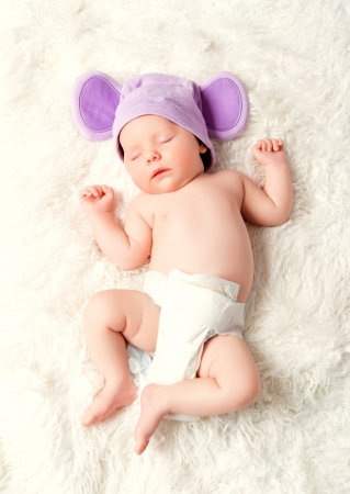 sleeps: cute newborn baby sleeps in a mouse hat with ears