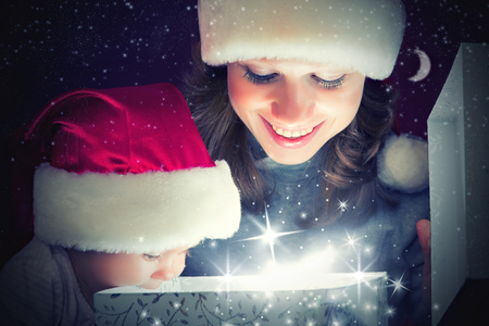 Christmas magic gift box and a woman happy family mother and Child baby Stock Photo - 22811354