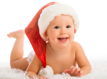 Beautiful funny baby in a Christmas hat isolated on white background photo