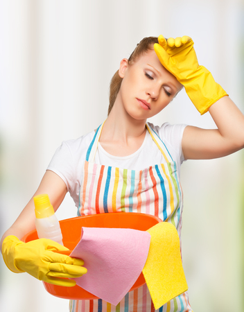beautiful young housewife is tired of housework photo