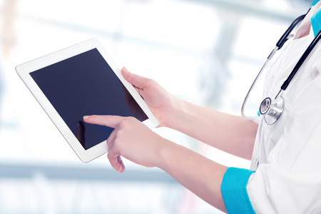 blank empty computer tablet in the hands of doctor